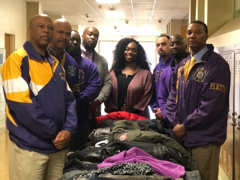 Psi Upsilon Donates Coats To Local High School Students.