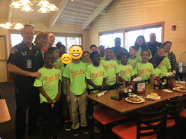 Hugh Bish students use reading skills, eat lunch with officers